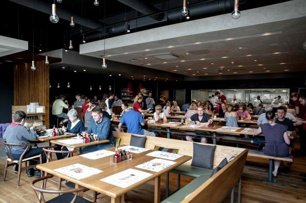 Hereford's Wagamama will feature a mix of tables and the chain's signature bench seating.