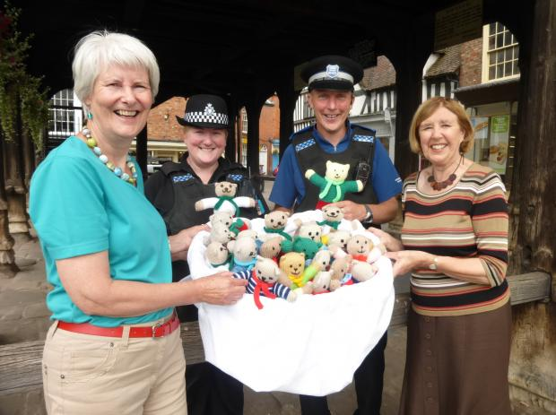 Hereford Times: BEAR NECESSITIES: Sally Holliday and Peta McCauley hand over teddies to PC Johnson and PCSO Alexander