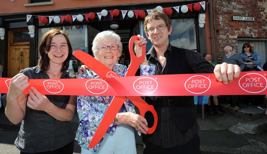 Retired subpostmistress Edith Duderley cuts the ribbon with left Kate Bellingham and Simon Cherry. PHOTO: Gavin Crilly Photography.