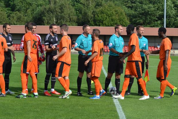 Hereford United's triallists shake hands with Be?ikta? and match officials before Monday's friendly.