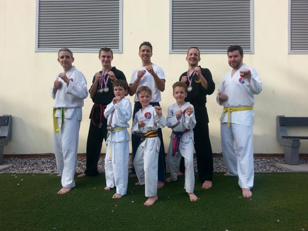 The Page Family Tae Kwon DO squad, back row (left to right) Jason Davies, Chris Davis, Brennen Page, Wayne Waldron, Jim Smith - front row Adam Smith, Jack Nielson, Jack Davies
