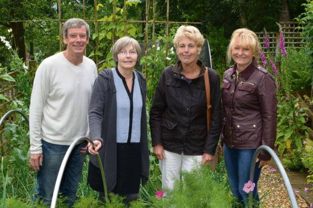 Eric and Veronica Martin opened up their garden for Llanfair Waterdine arts and gardens festival. They are pictured with visitors Sarah Griffiths and Anita White.