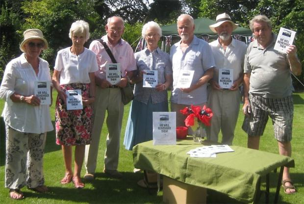 Members of the Friends of Stoke Lacy Church with copies of We Will Remember Them. (from left); Chris McNaught, Daphne Montandon, chairman John Caiger, Janet Parker, David McKeeman, author Adrian Yeeles and Nigel Montandon.