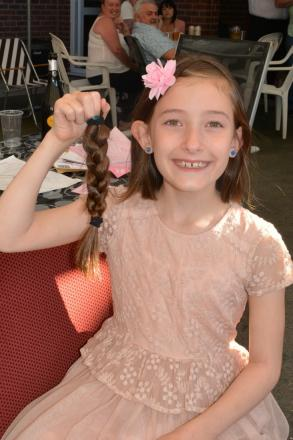 Eight-year-old Emelia Watts has had her hair cut off for charity.
