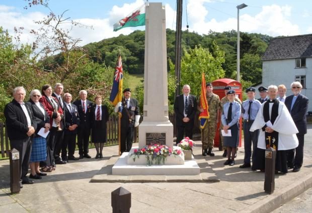 Some of those who attended the commemorative event around Llangunllo's Memorial Cross.