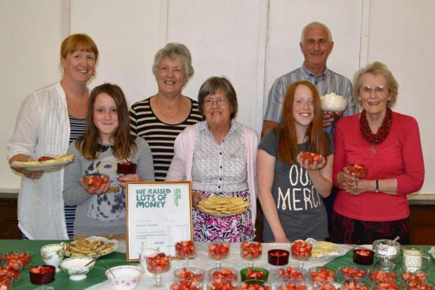 Group secretary Louie Hardwick, treasurer Pam Mills, volunteer Mike Conway, front Emma Bywater, vice chairman Margaret Johnson, Heidi Waddington and chairman Liz George at the strawberry tea.