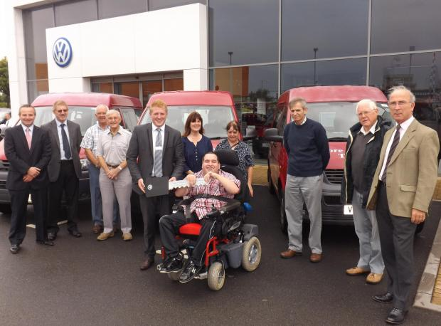 (From left) Colin Barker (aftersales director), Barry Selway (sales manager at Courtside Conversions Ltd), David Lindley (volunteer driver), Chris Tomlinson (volunteer driver and fleet manager), Steve Amos (commercial sales manager), Pauline Francis (clie
