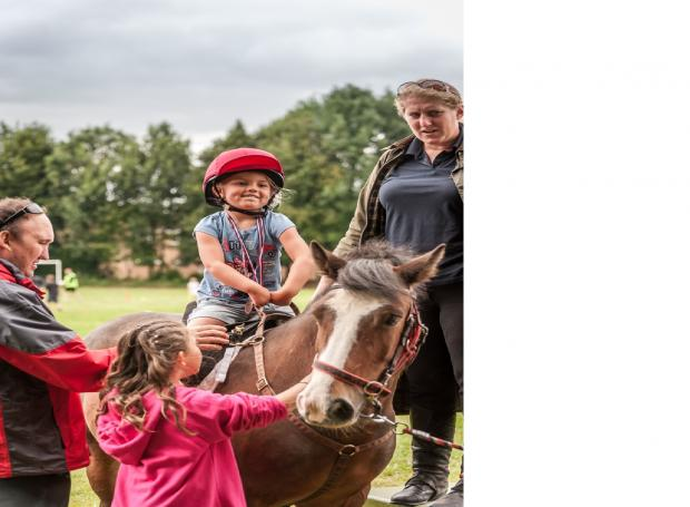 Riding for the Disabled's Fenella Bennett provided pony rides at the Grandstand Community Games.