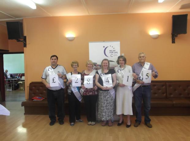 Pictured are members of the volunteer committee; Alan Randell, Maureen Beers, Carole Fryer, Wendy George and Mick Fryer, together with Maria Parker, Cancer Research UK local fundraising manager.