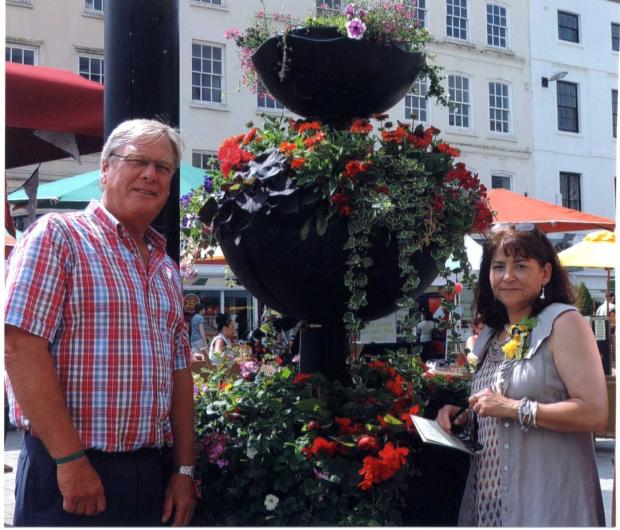 Lions Club member Ian Foster is pictured showing Britain in Bloom judge Nicola Clarke one of the High Town planters sponsored by Lions.