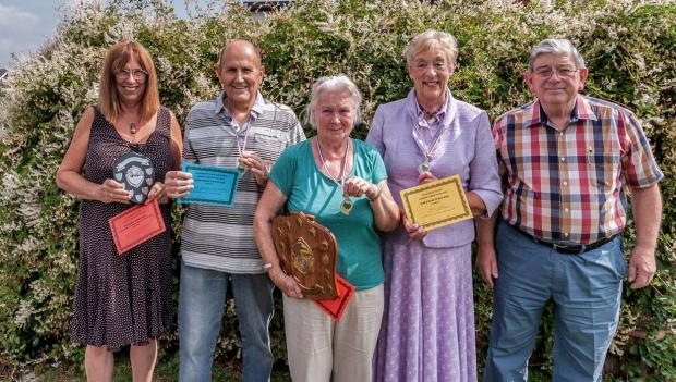 Kitty McKirdy (centre) won the Queen's Diamond Jubilee Shield for Best Garden for 2014. She is pictured with some of the other prize winners.