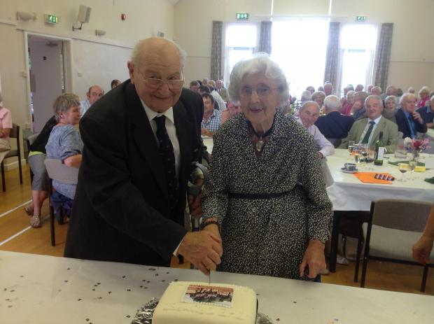 Two stalwarts of the society, Mrs Joanne Probert and Mr Tony Cotton are seen here cutting the celebratory cake.