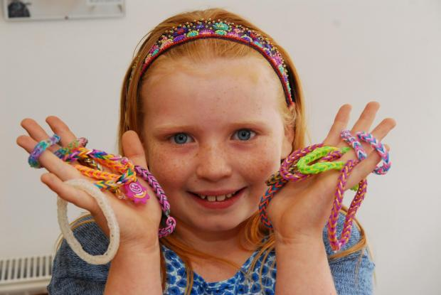 9 year old Anne-Mae Potter sold loom band in aid of Acorn's Hospice. ENDS (9754930)