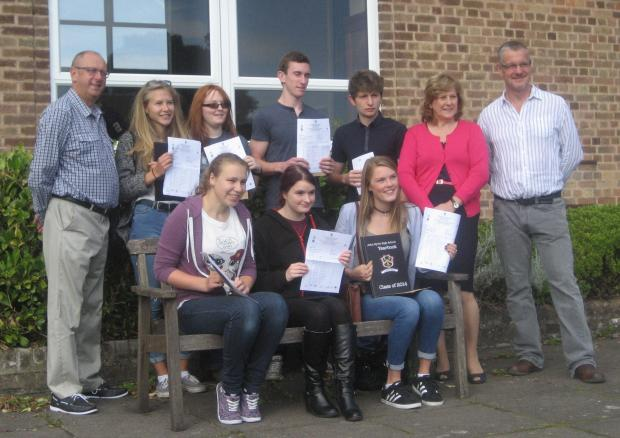 Staff and students at John Kyrle High School celebrating their GCSE results.Back row, from left, is: Nigel Griffiths (head teacher), Emma Ormiston, Sophie Wilkes, Nick Burden, Benny Bornoff, Karen Frost (chairman of governors), Mark Croad (assistant headt