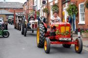 A parade of vintage farm machinery through Bromyard. Photo: Eye Contact Media.
