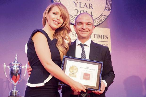Charity campaigner Katie Piper presents Dorian Gonsalves with the  'Lettings Agency of the Year' award for 2014.