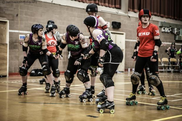 Kim Wild, Zoe Butler and Jessica Warrington line up in the Bulls' game against Swansea City Roller Derby earlier in the year. Photo: Questionmark Photography.