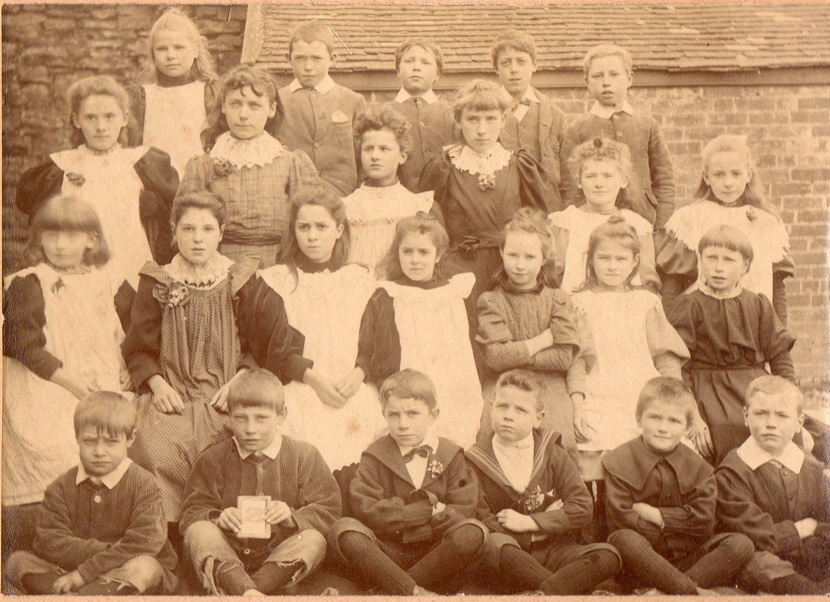 Leintwardine schoolchildren in the 1890s. Percy Malpas (born 1890) second right, and behind him are his sisters, Florence (born 1888) and Gertrude (born 1886)