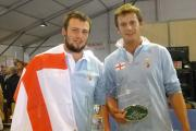 Victory for England: Sam Bullingham (left) and Richard Carter with their team flag and trophies.