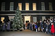 The winners of the competition to illuminate Downing Street with Christmas decorations gather outside Number Ten.