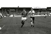 Mark Jones (right) challenges Manchester United's Brian McClair during the FA Cup game.