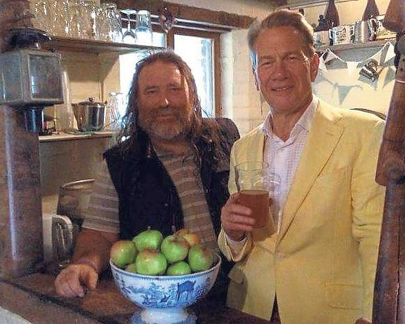 Denis Gwatkin (left) and Michael Portillo (right) in the cider house at the farm.