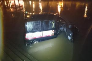 Taxi careers down steps into the river Severn