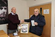 David Davies has got his season ticket. He is seen here (right) with Hereford FC volunteers co-ordinator Ken Kinnersley. Photo: JAMES MAGGS