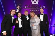 From left, BBR Directors Nick Rumney and Nick Black proudly show off the Enhanced Services Award trophy with host, comedian Ed Byrne, at the Optician Awards 2015.