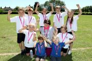 2715900801 Paul Jackson 30.06.15 Ledbury - Svetlana Zenihova, learning support practitioner with pupils from Ledbury Primary School who ran a race for life at the school to raise money for Cancer Research UK. (30604349)