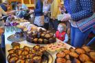 Max Ramsden-Acraman eyeing up some sweet treats at the Macmillan coffee and cake event