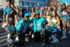 Walking Wounded team arrive in Hereford's High Town to be greeted by the Miami Dolphins cheerleaders and former players.