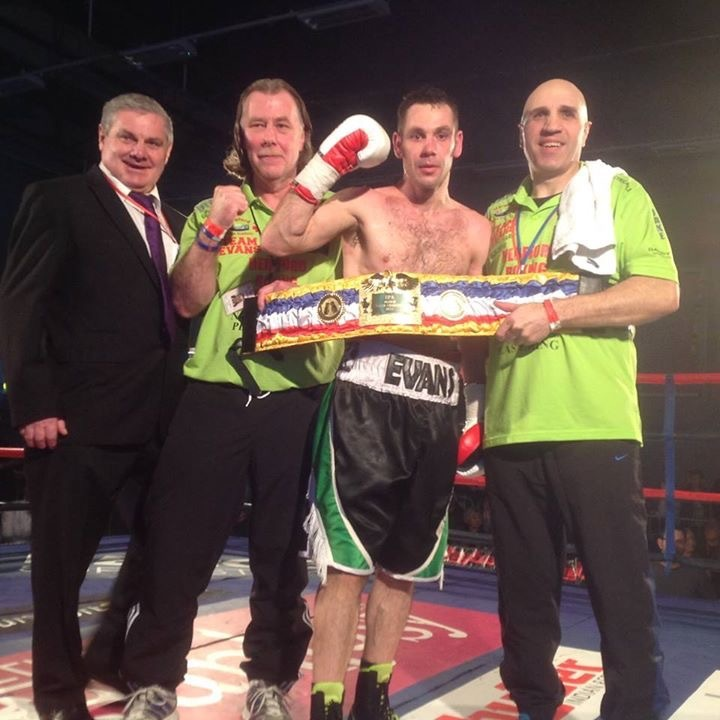 Dean Evans celebrates his win with, from left: Promoter Keith Mayo, Hereford Boxing Academy's Neil Gibbons and trainer Joe Wrona