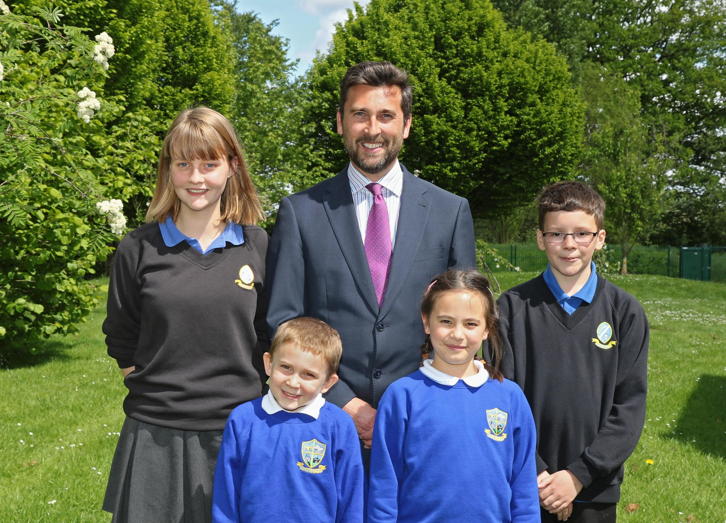 Year 10 pupil Phoebe Benbow, reception pupil Xander Weston, head teacher Dean Williams, Ellie Pilliner, from year three and Sam Carpenter from year seven. Photo: Emma Pollock.