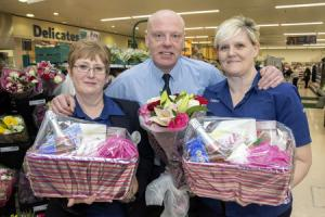 WN_210317_18 Paul Jackson 21.03.17 Ledbury - Tesco Ledbury are looking for a mum that deserves a special hamper as part of a competition. From left - Pat Johnson, customer service, Mel Yates, store manager and Jan Pugh, customer assistant..