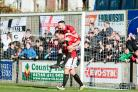 Jamie Molyneux jumps on Mike Symons' back after the Hereford striker made it 4-0. Photo; John Rose Photography