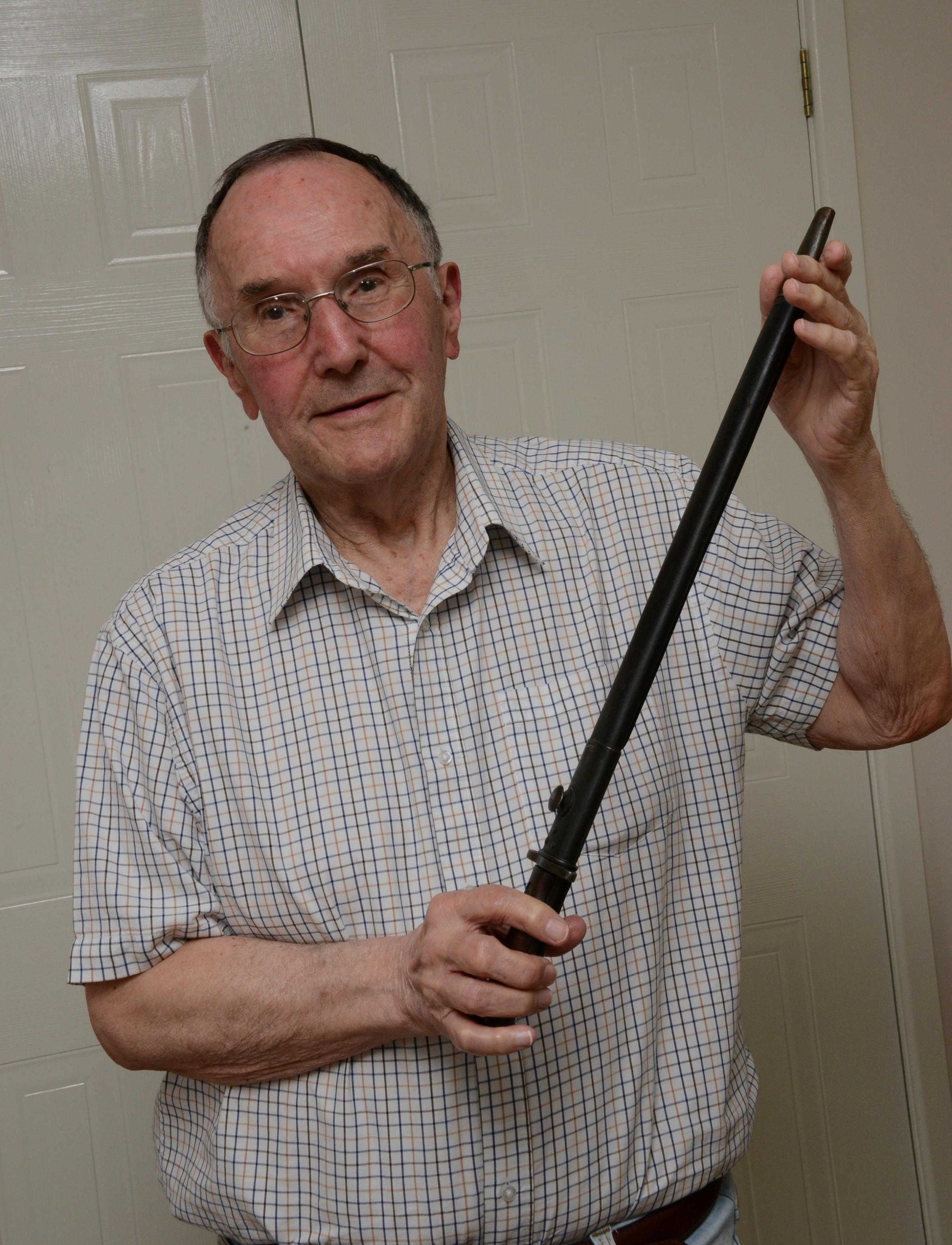 Ray Haycock with World War One bayonet similar to the one which belonged to his father. Ray with the bayonet from Kington museum. 1729_6003.