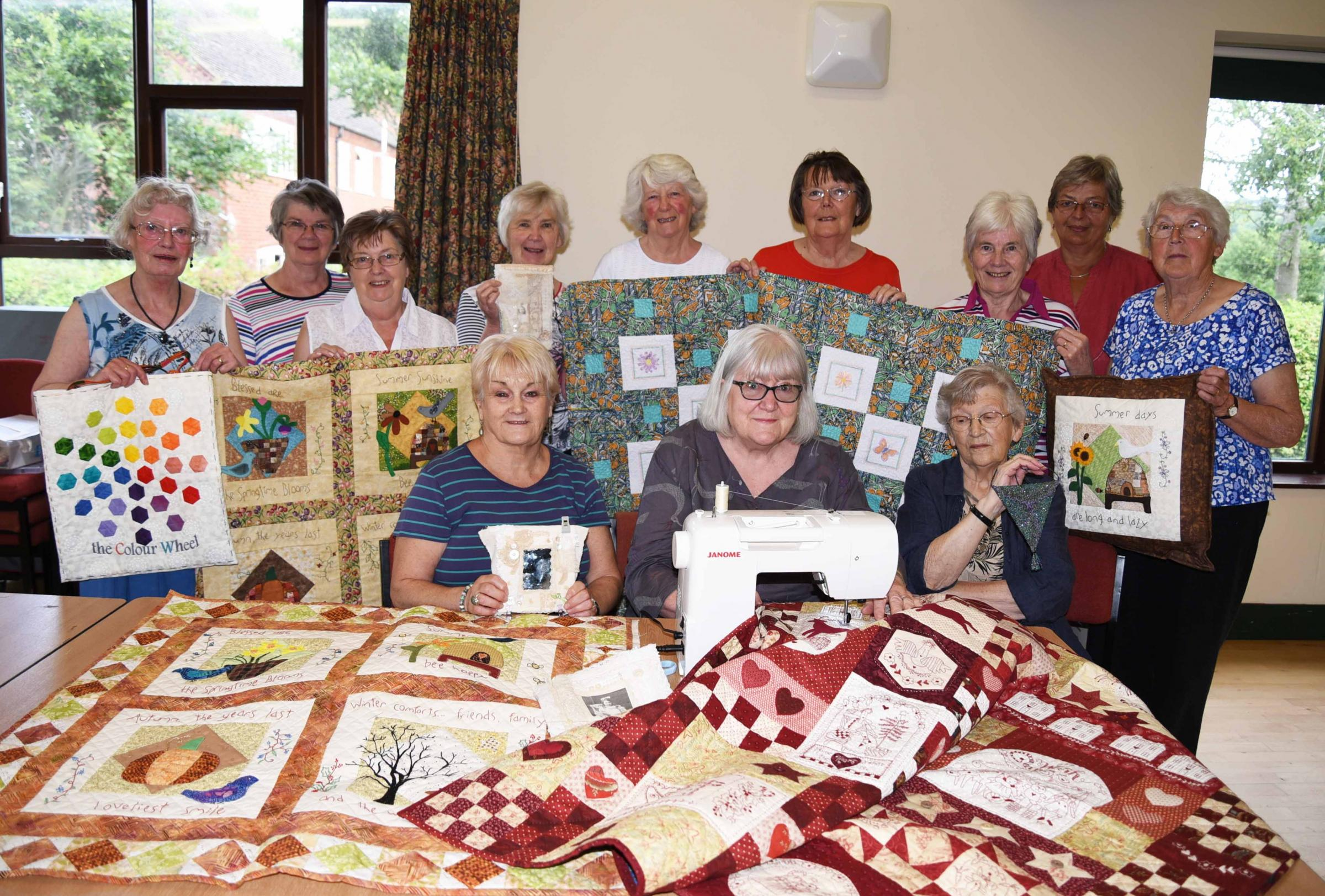 Members of Lingen Stitchers preparing for the event Maggie Flanders, Glenys Price, Ethel Joyce, Rene Morris, Sheila Davidson, Jane White, Anne Thomas, Claire Bordewey, Phyllis Jones, front Margaret Thorpe, Chris Body their tutor and Kath Morgan