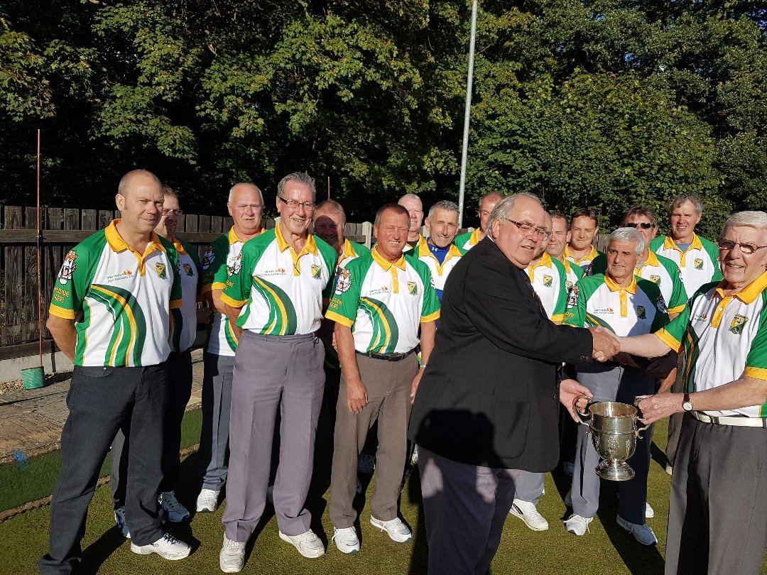The bowling club being awarded their trophy