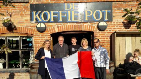 Fiona Manns and Maureen Stewart of Hereford French Circle fly the flag outside their new venue, along with Gary, Sam and Sean from De Koffie Pot in Bridge Street