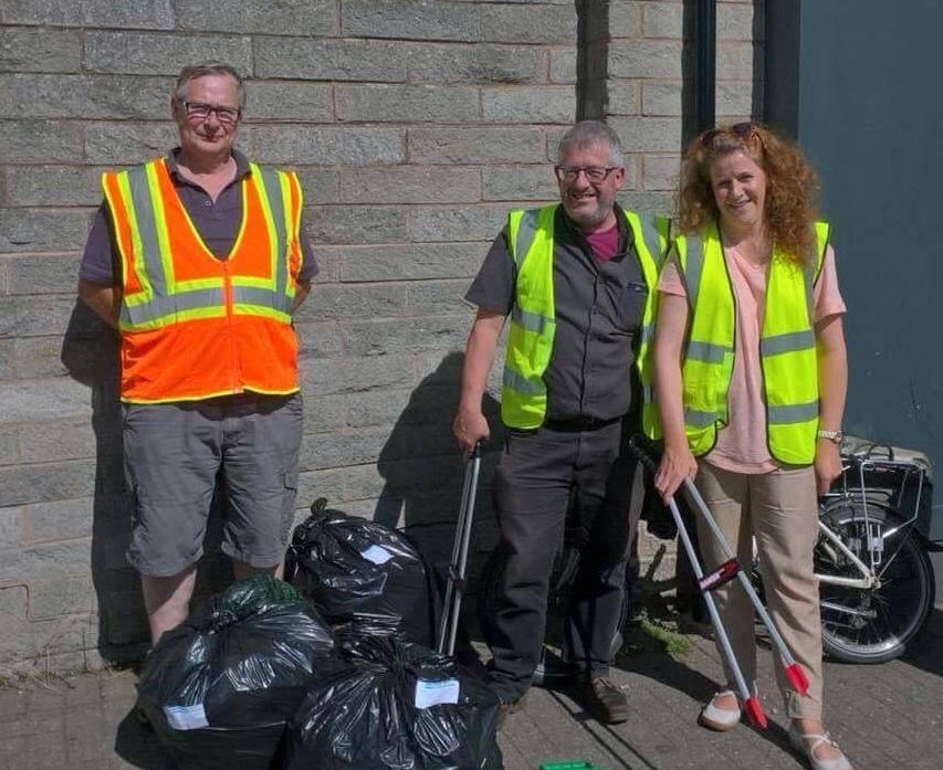 Andrew Wood, Mark Edwards and Emma Jones carrying out a litter pick