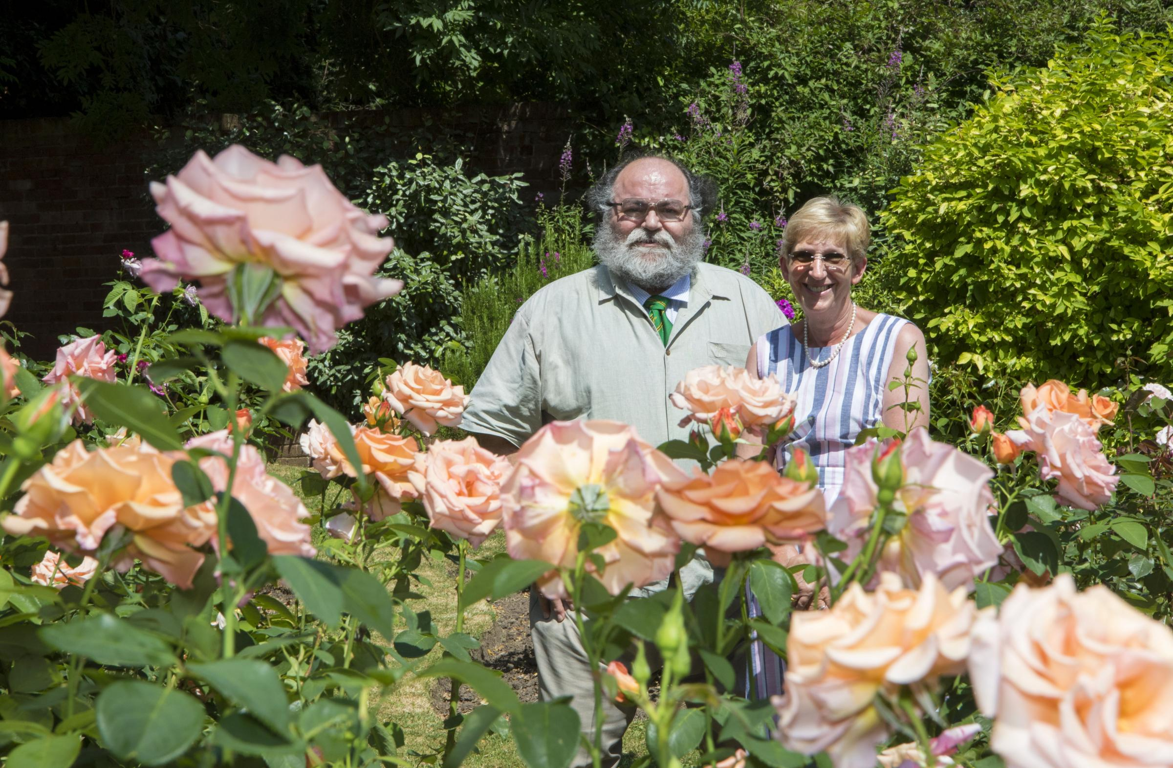 WN_180717_10 Paul Jackson 18.07.17 Ledbury - Clive Green, chairman Ledbury in Bloom and Christina Vass, vice chairman Ledbury in Bloom, with the rose garden in The Walled Garden which was praised during Heart of England in Bloom judging..