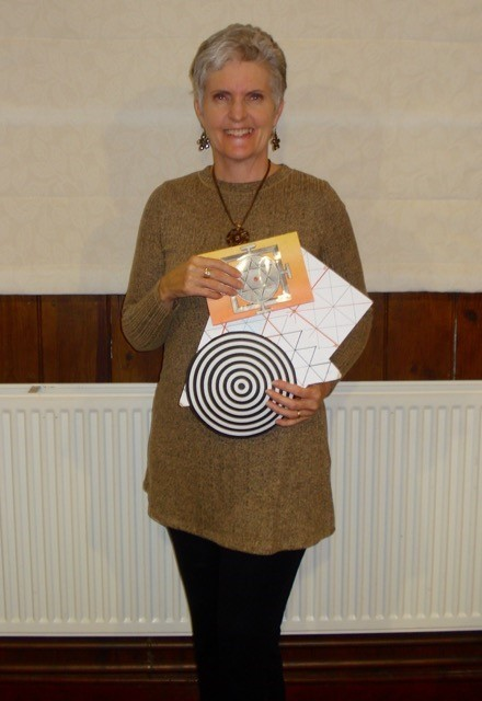 Artist and mathematician, Karen L French, with some symbolic shapes from her collection of templates