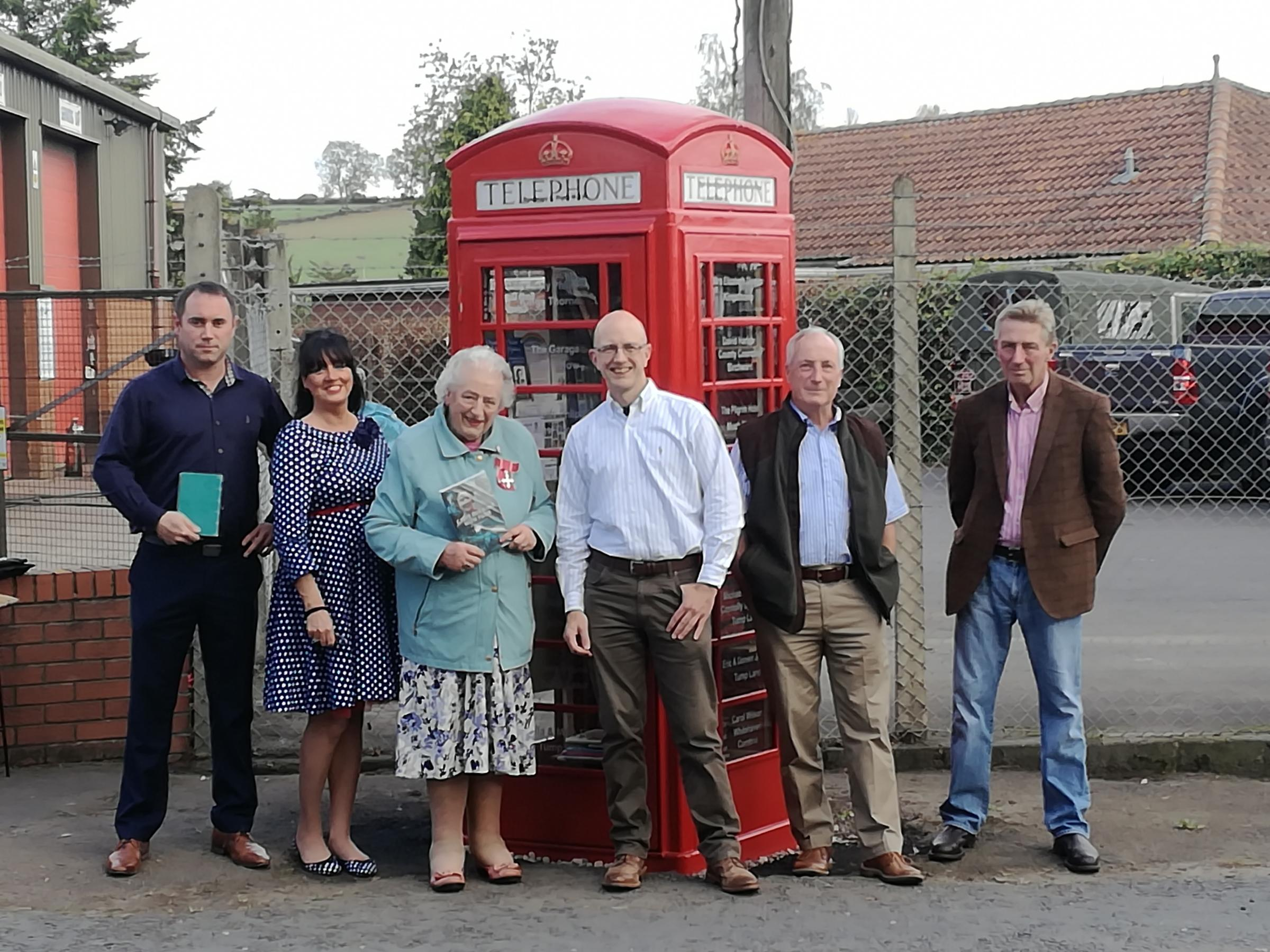 At the opening of the Wormelow telephone box library, some of those present were, from left, Trevor Forrester, Ruby Mann, Rosemary Rigby, John Prime, Andy Mann and Cliff Hiscox.