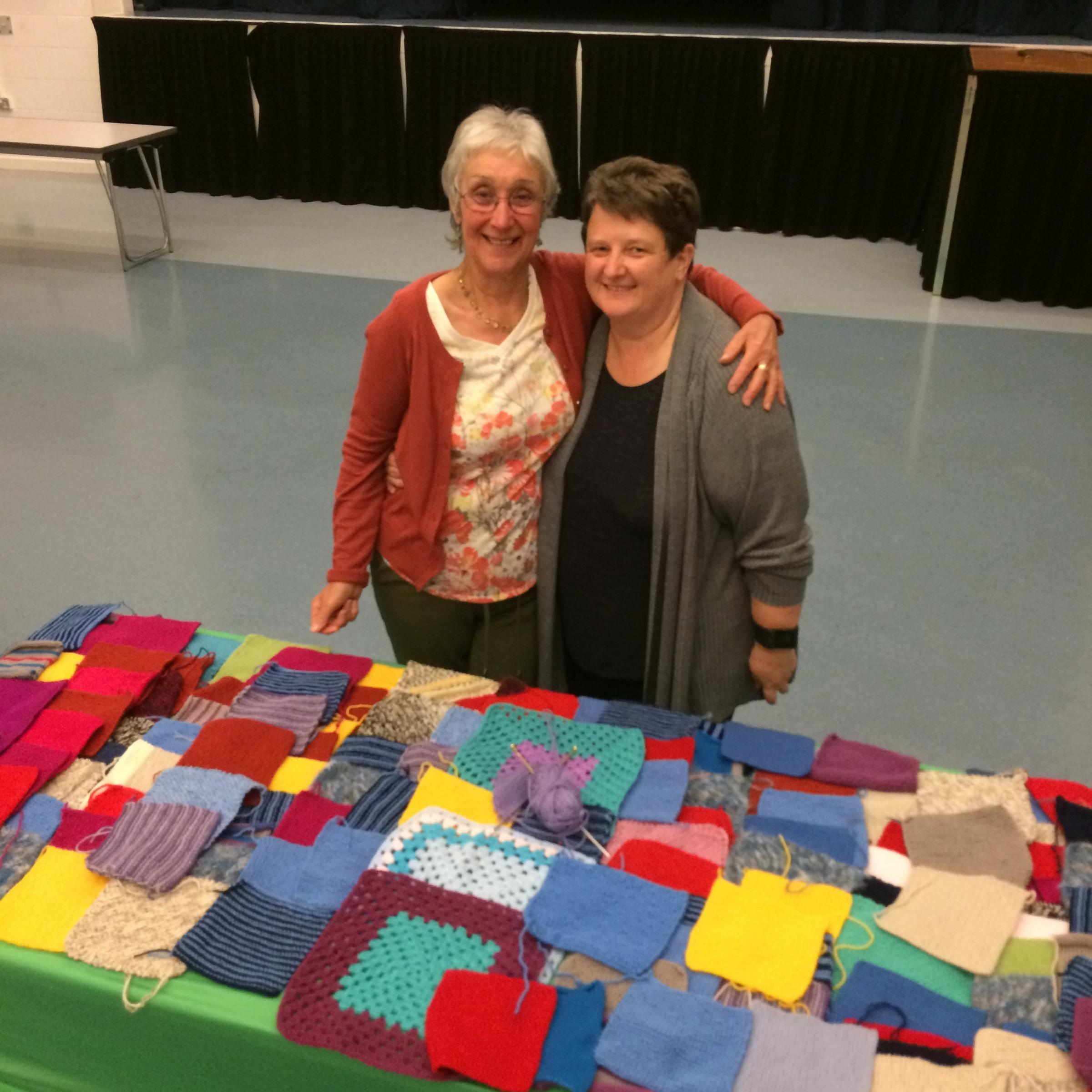 Ruth Davies and Fiona Catada, volunteer helpers at Weight Watchers meeting in Whitecross Hereford High, display some of the knitted squares