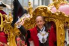 The new Lord Mayor of London Charles Bowman waves from his carriage. (Dominic Lipinski/PA)