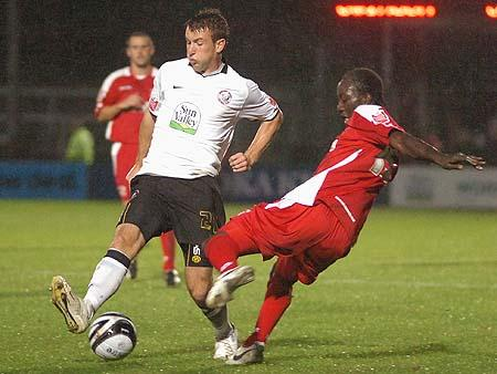 Andy Williams wins the ball against Kevin Amankwaah.