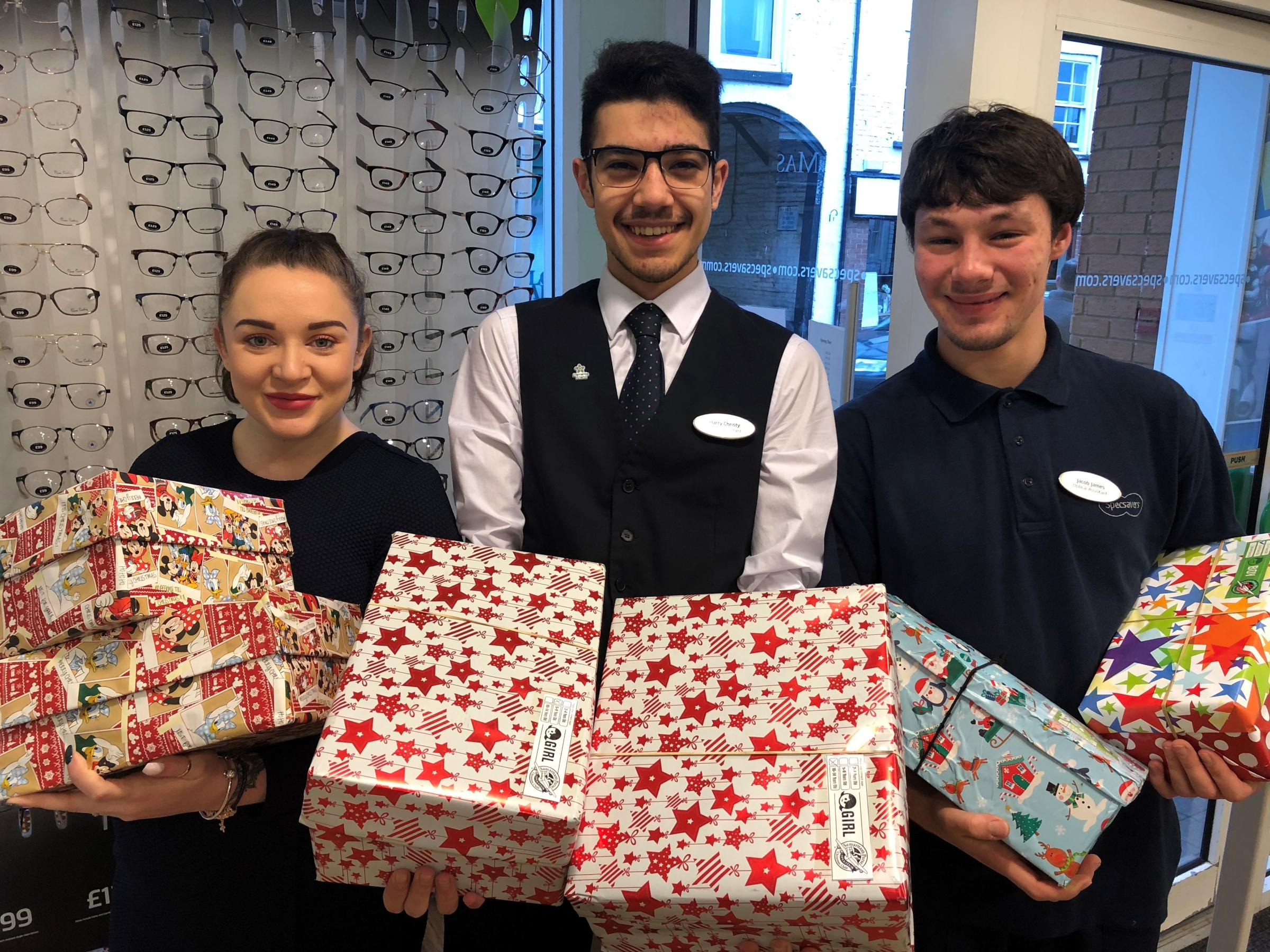 Leominster Specsavers staff Meg Morris, Harry Christy and Jacob James with some of the Christmas boxes.