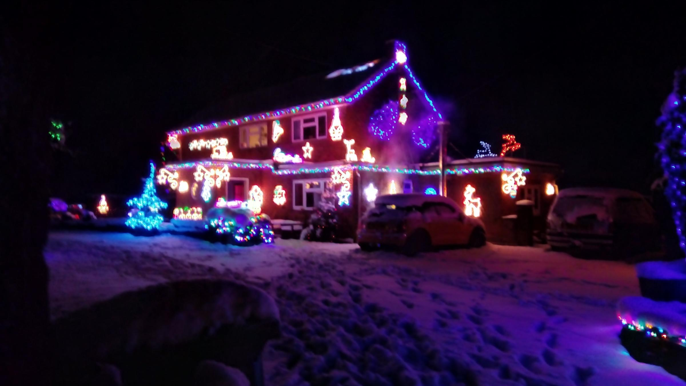 Father and daughter team\'s Christmas lights display returns in ...