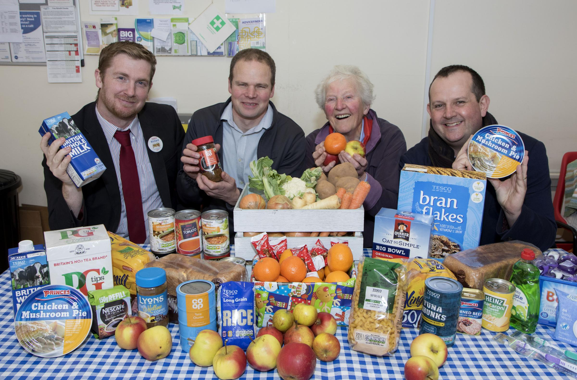 WN_191217_06 Paul Jackson 19.12.17 Ledbury - Ledbury Foodbank has seen a seasonal rise in the number of users. From left - Richard Barnes, fresh trade manager, Tesco, Richard Brixley, Co-op store manager and foodbank volunteers..